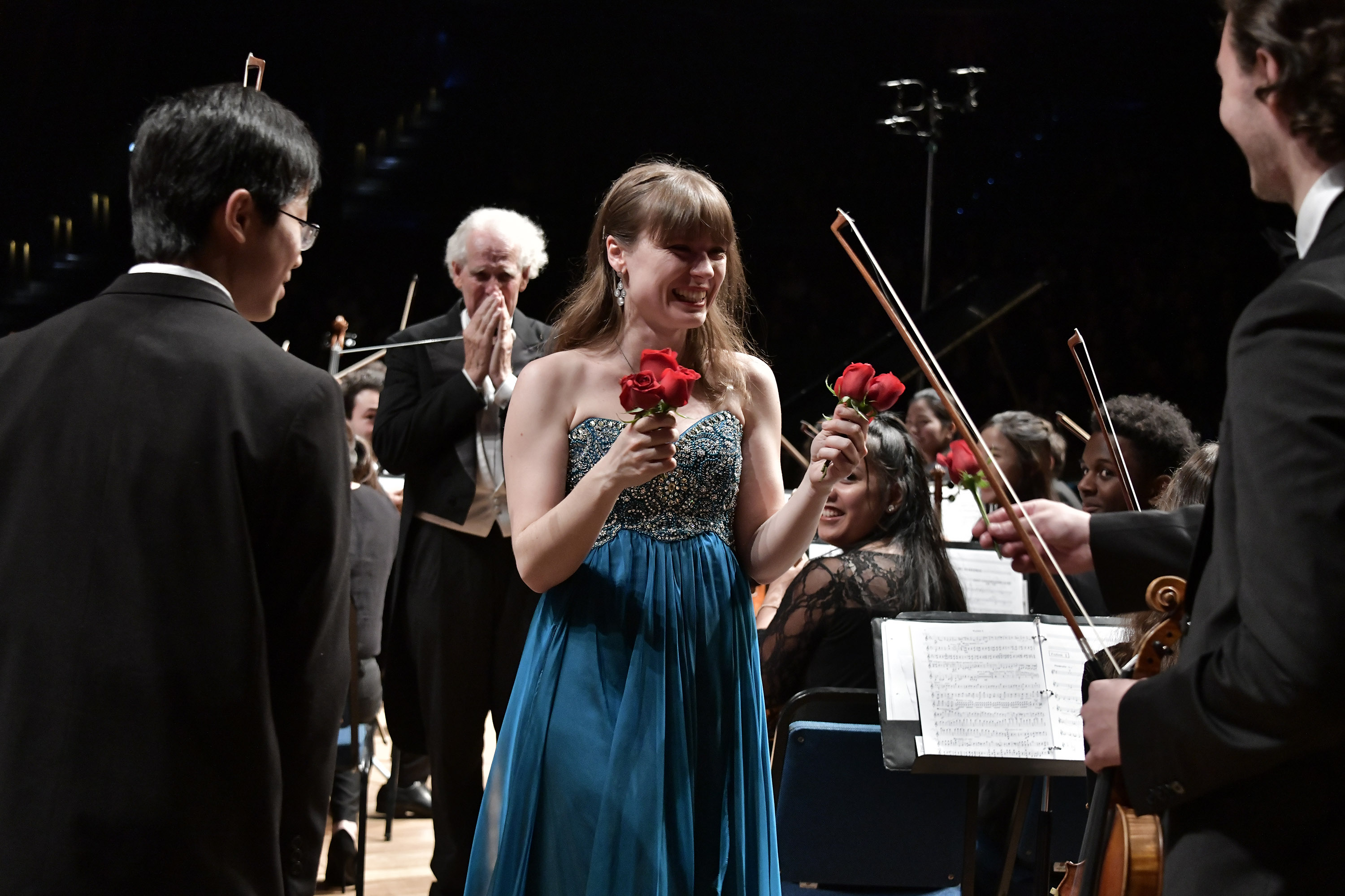 Fedorova receiving roses from BPYO violinists following her last Rach Two with the BPYO in Curitiba's Teatro Positivo