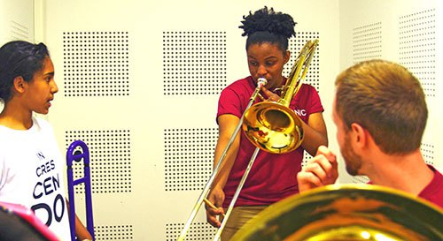 BPYO Trombonist Robyn Smith works with In Crescendo students